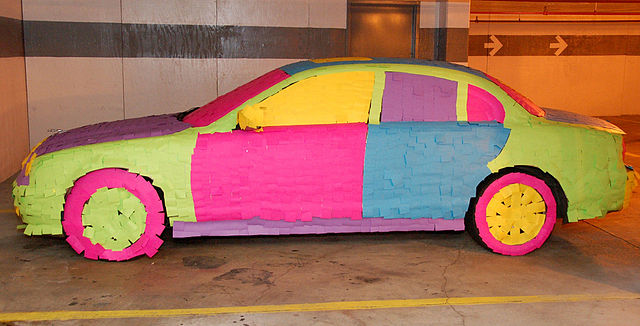 A car was completely covered in sticky notes as an April Fools prank, a common prank to pull on co-workers or employees.  Photo Courtesy of Wikimedia Commons