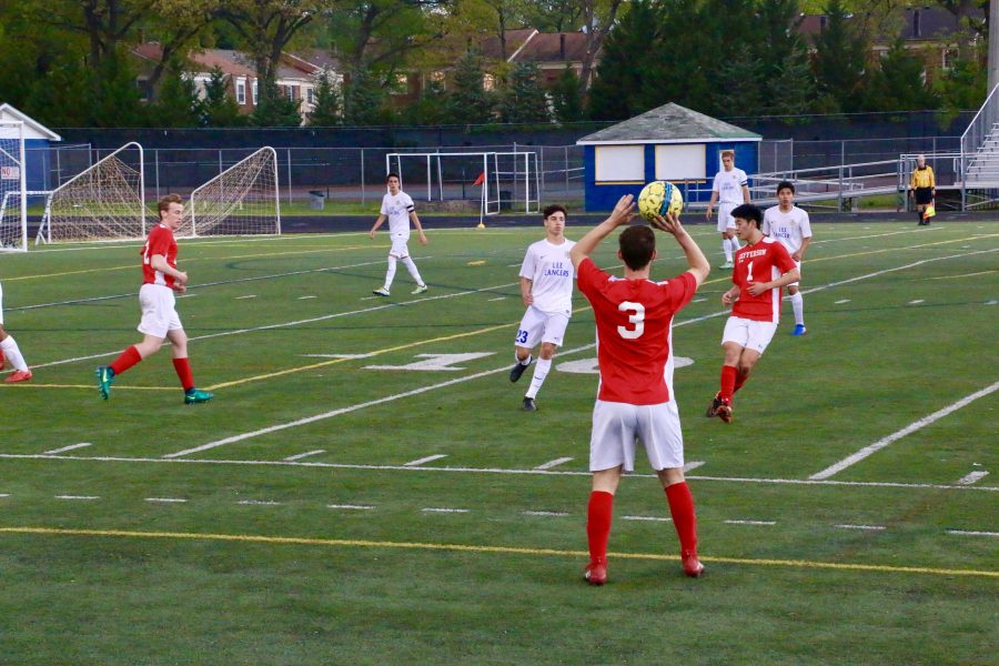 Senior Jake Nash completes a throw-in during Jeffersons varsity soccer game against Lee High School.
