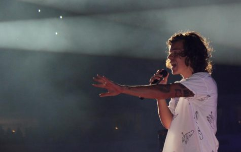 Harry Styles performing with One Direction.