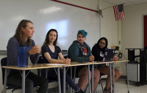 From left to right, senior Sam Libberton, senior Sofiya, junior Ash Rozzi and senior Shraddha Pradeep hold the panel during A-block.