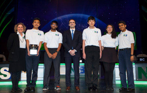 Science Bowl coach Laura McConnaughey, and members Franklyn Wang, Neeraj Prasad, Charles Wang, Joyce Tian and Aaditya Singh receives the 2nd place prize with Michael Kratsios, Deputy Assistant to the President and Deputy U.S. Chief Technology Officer in D.C..