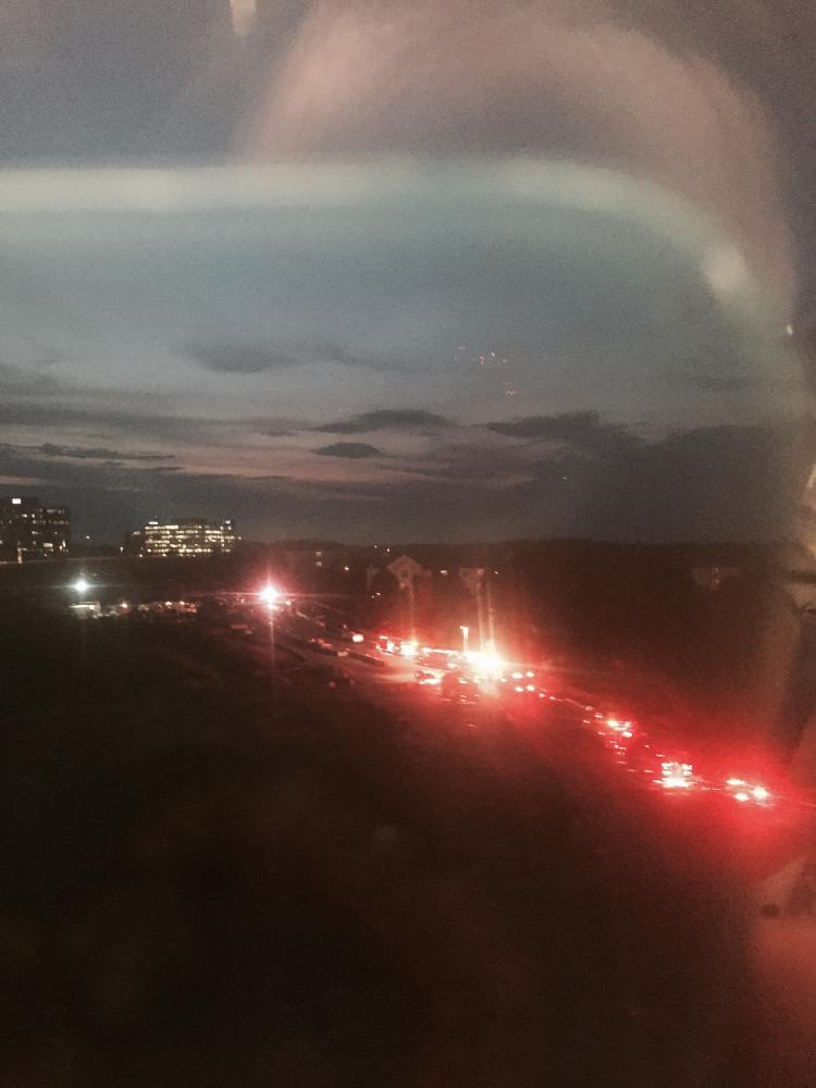 A line of fire and emergency trucks respond to an accident in Tysons Corner, as viewed from the Metro, on Aug. 22.