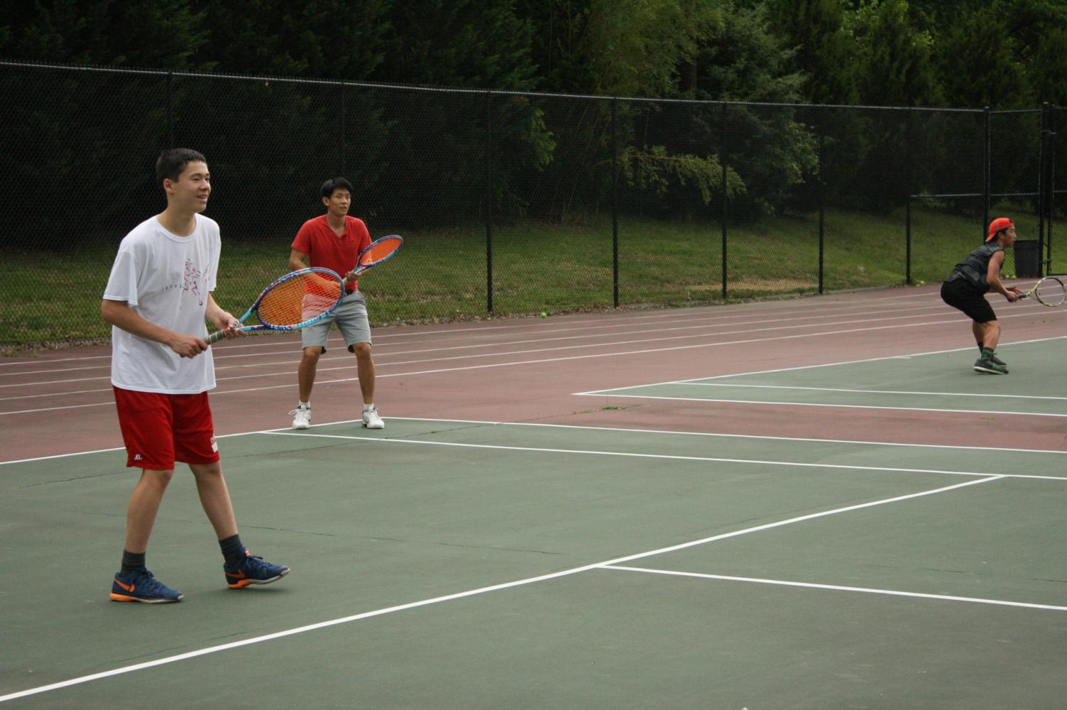Freshman William Vroom and Senior Ruyan Zhang practice ahead of the state championship. Hard work and practice makes quality tennis players who can win championships.