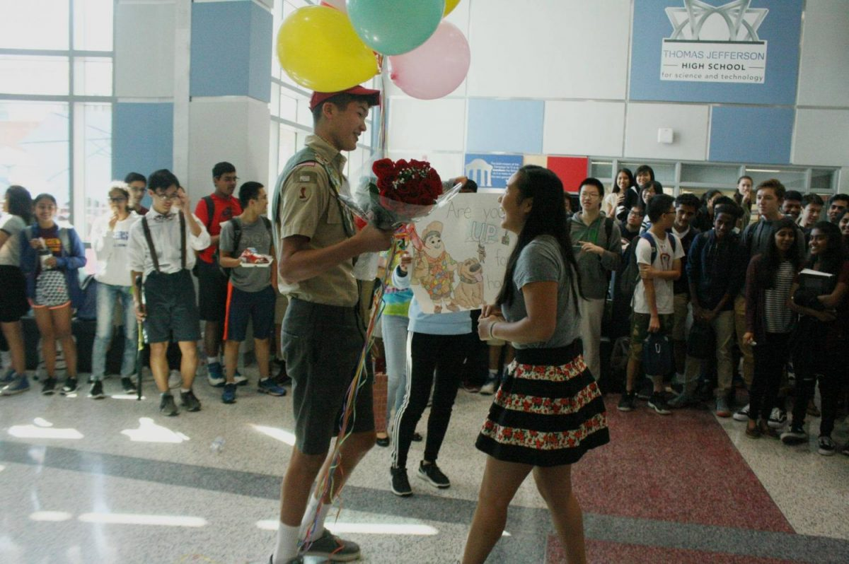 Senior Vincent Carter asks senior Lilly Ko to homecoming in the Nobel Commons.