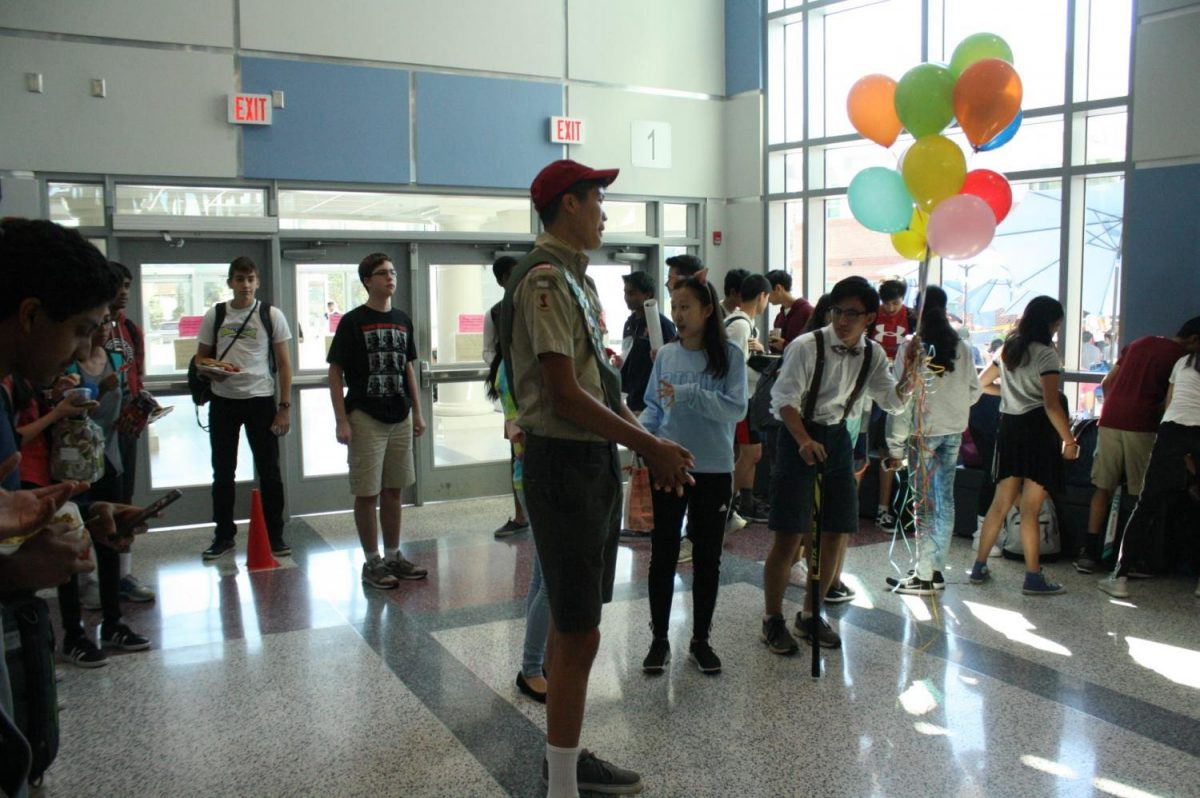 From left to right: Seniors Vincent Carter, Katie Zhang, and Nathan Stroh dress up as characters from Up for Carter's asking.