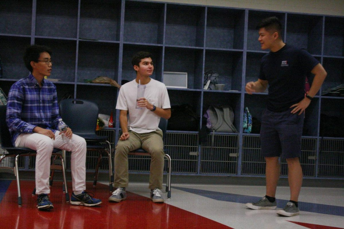 From left to right: Seniors Will Sun, Nick Begotka, and Justin Zhou reenact a scene from