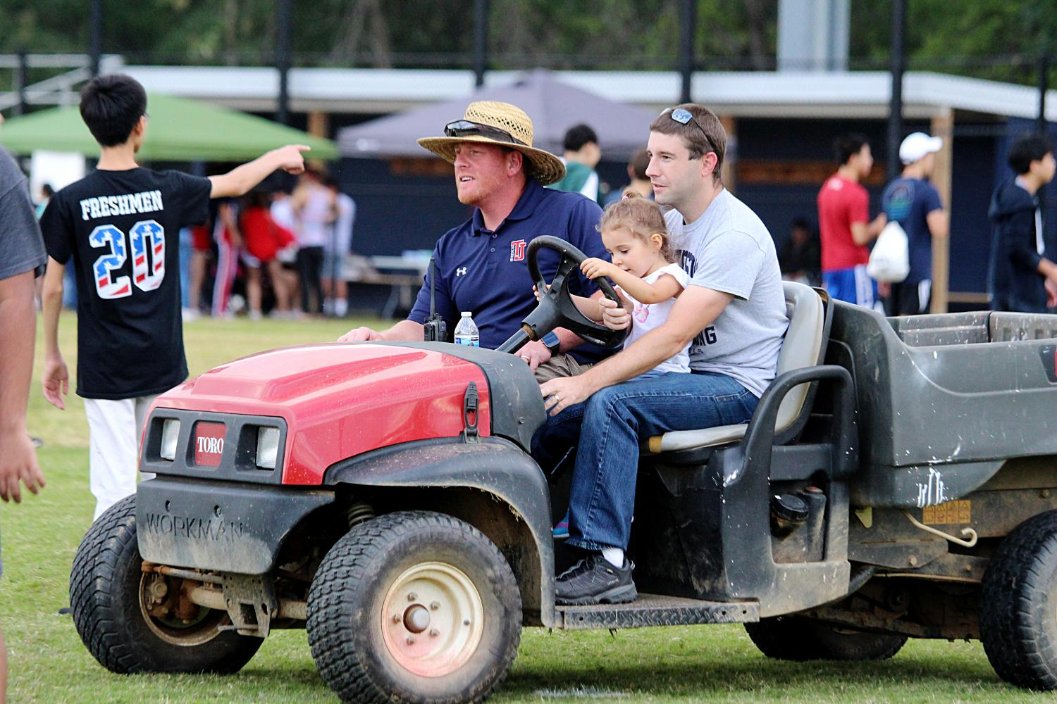 David Gardzel and Clint Behling drive around the Back-to-School Bash with Behling's daughter.