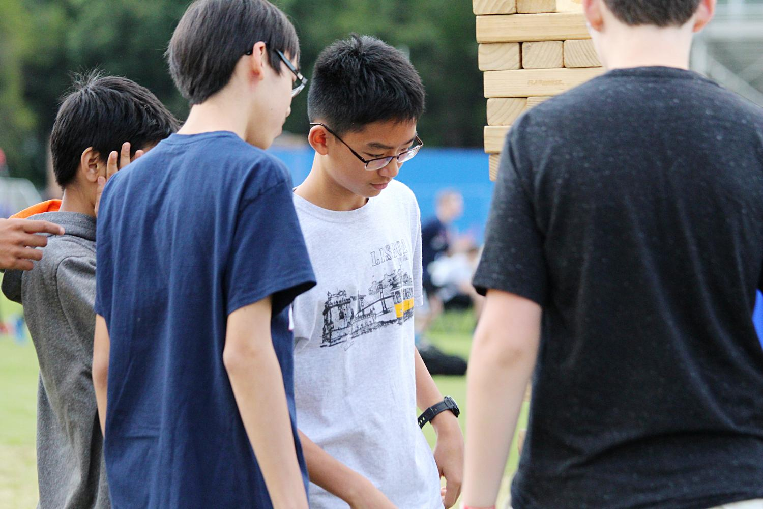 Sophomore Joshua Gong carefully eyes the Jenga structure before his next move.