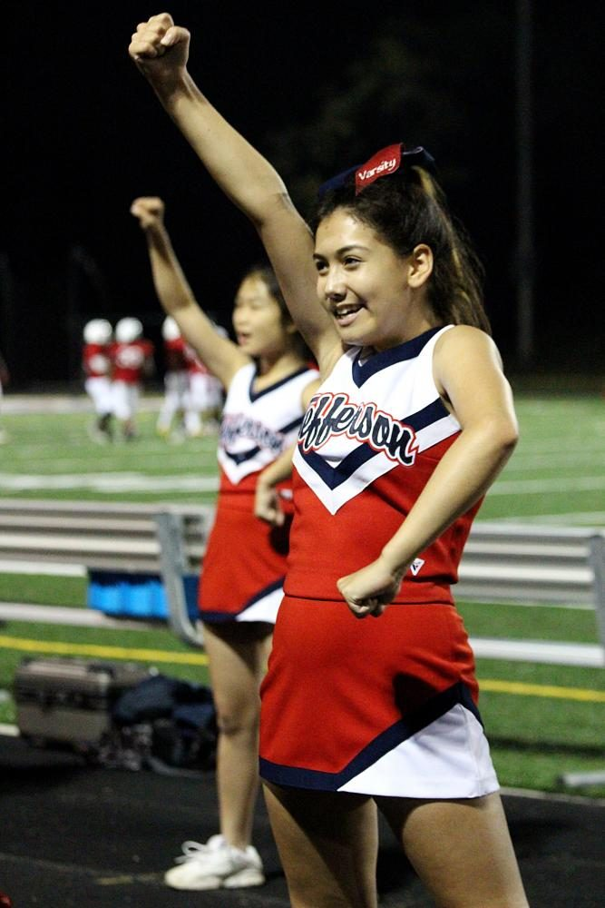 Junior Julia Martinez strikes a pose in the middle of a cheerleading routine.