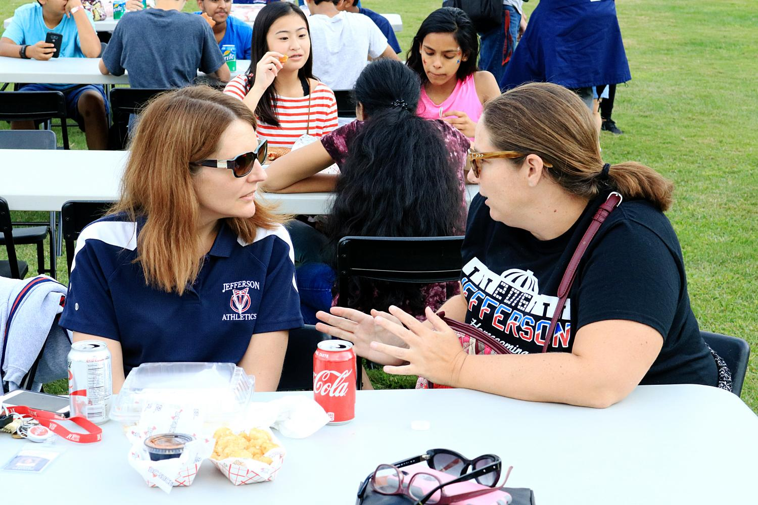 From left to right: Teachers Denise Castaldo and Marianne Razzino chat alongside other teachers and students.