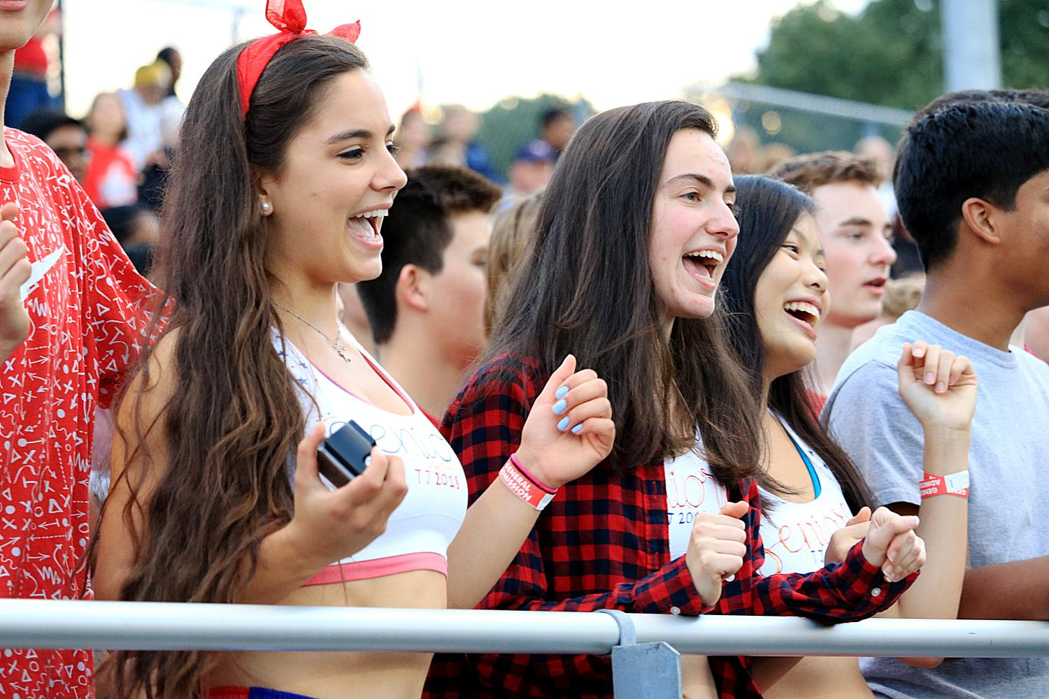 From left to right: Seniors Artemis Veizi, Mara Casebeer, and Jessica Ly cheer on the football team from the stadium.