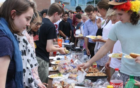 Jefferson students and their German exchange students set up in line for the Oktoberfest food, provided by the German Honor Society members.
