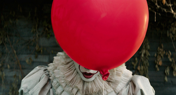 Photo+courtesy+of+Warner+Bros.+Pictures.+Pennywise+the+Dancing+Clown+hides+his+face+behind+a+red+balloon+before+confronting+one+of+his+victims.