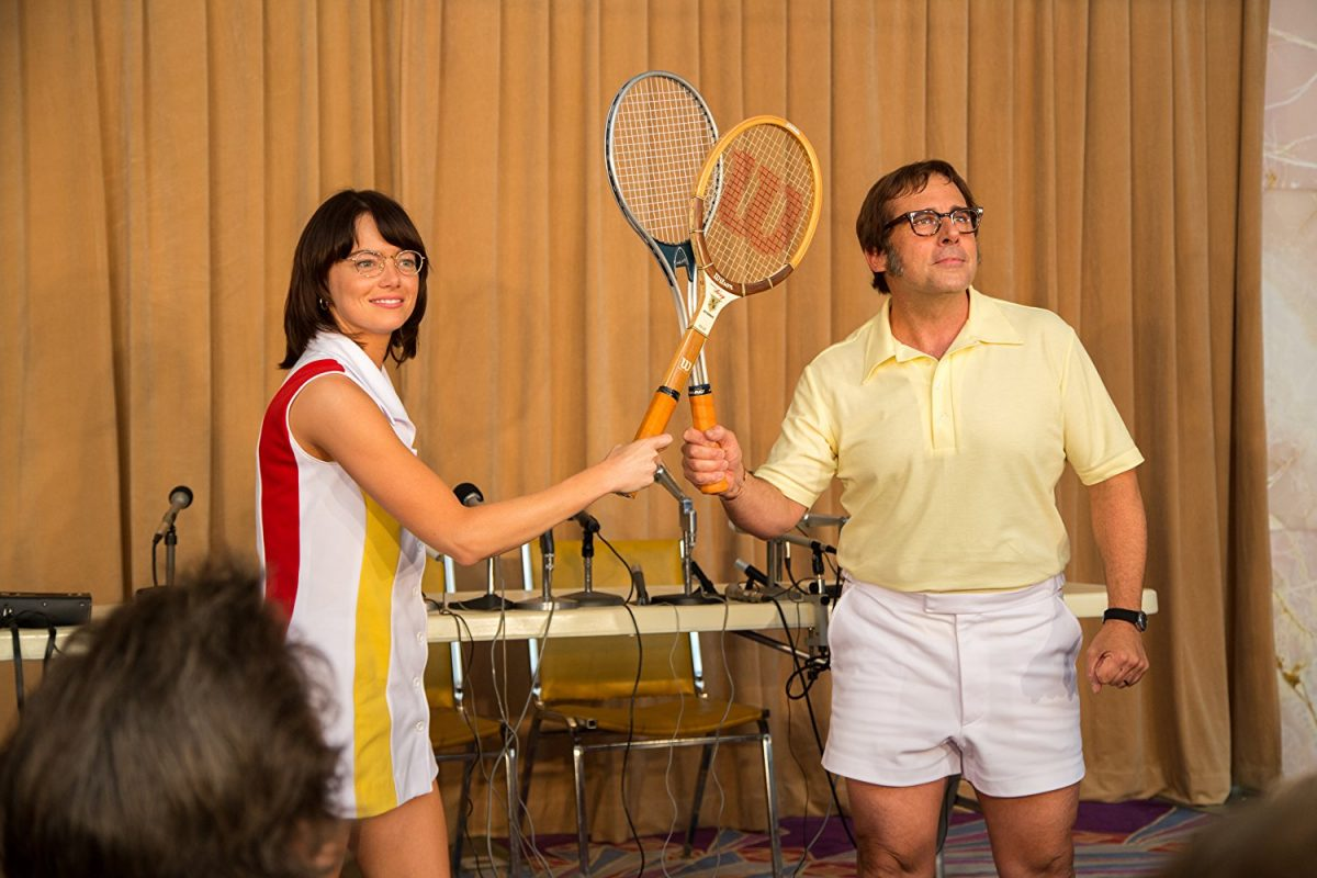 "Billie Jean King (Emma Stone) and Bobby Riggs (Steve Carell) interview and pose for the press before their major tennis match, known as the ""Battle of the Sexes."""