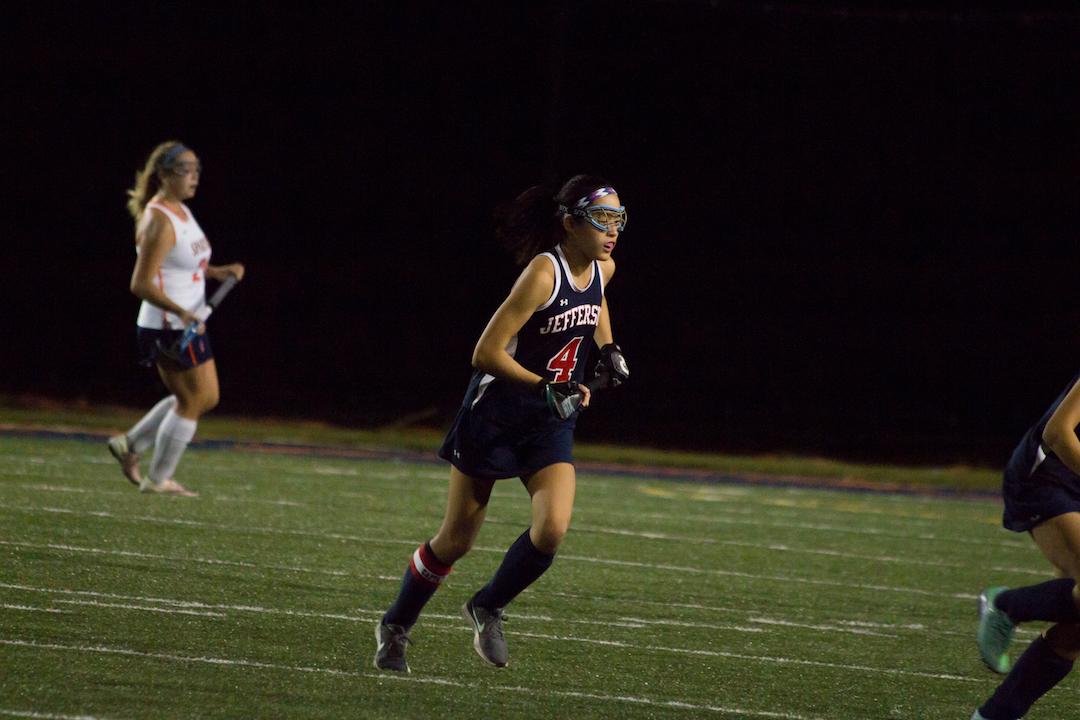 Senior+Maddie+Min+runs+across+the+field.