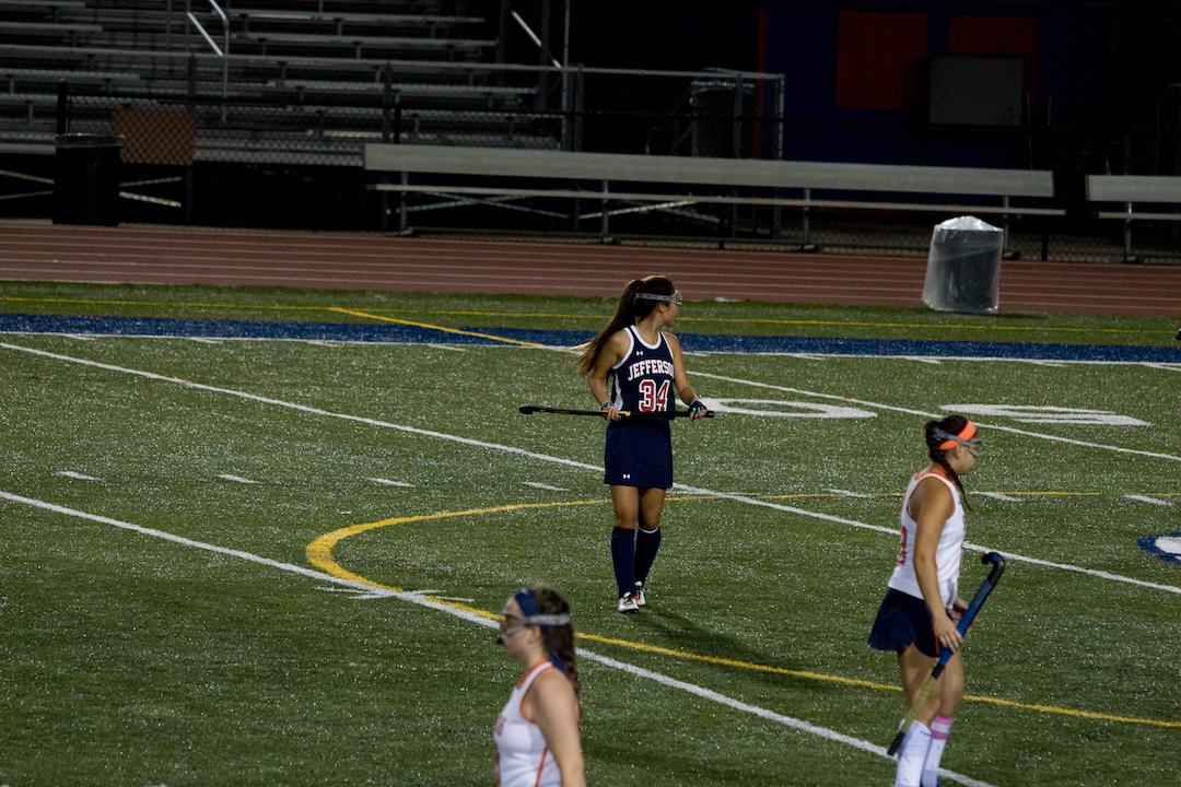 Sophomore+Ella+Nguyen+walks+across+the+field.