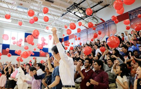 Seniors toss red balloons into the air at the end of their