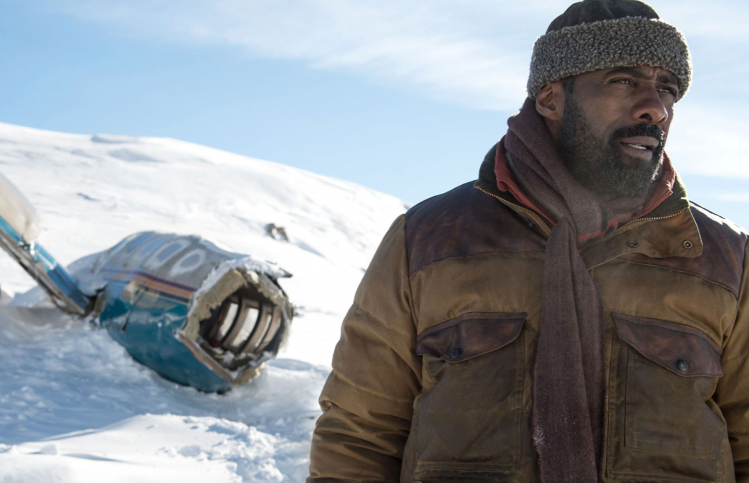 Photo courtesy of 20th Century Fox Pictures. Bass (Elba) considers whether to stay, in hopes of a rescue, or to abandon the plane in search of help.