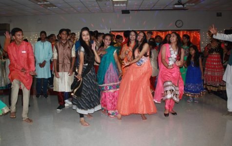 Attendees of the Diwali celebration during an impromptu dance-off pitting underclassmen against upperclassmen.