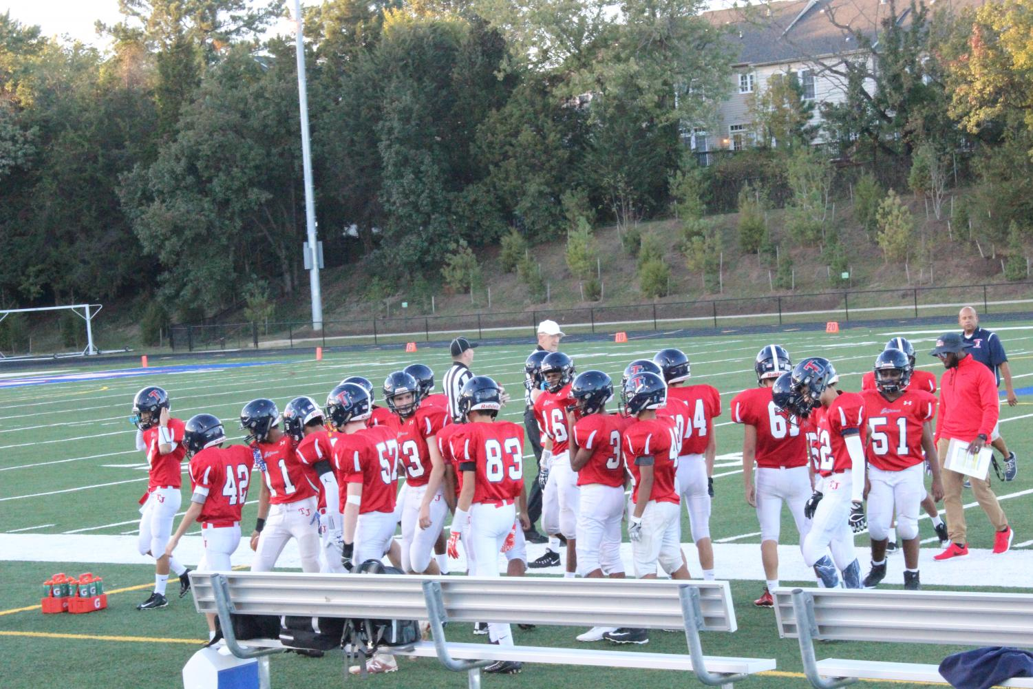 The JV football team meets up before the start of the game against JEB Stuart on Oct. 19.