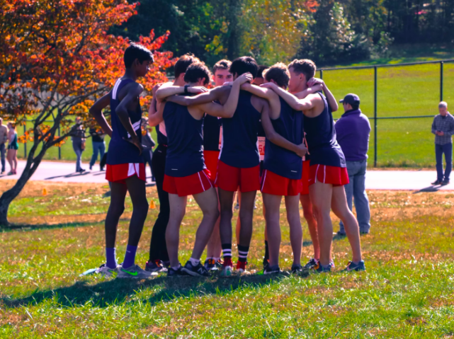 Huddled+together%2C+Cross+Country+athletes+chant+the+maxim+%E2%80%9CI+Believe+That+We+Will+Win%E2%80%9D.+On+Oct.+17%2C+with+the+annual+district+conference+promptly+approaching%2C+Jefferson+sprinters+energize+their+spirits+through+optimism+and+reassurance+for+their+impending+mark+of+success.+