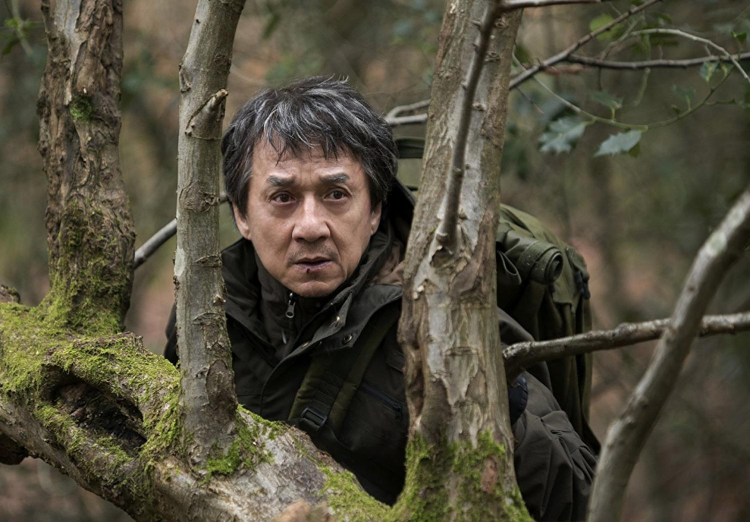 Photo courtesy of imdb.com. Quan (Chan) hides in the woods from pursuing attackers of the IRA sent by Hennessy.