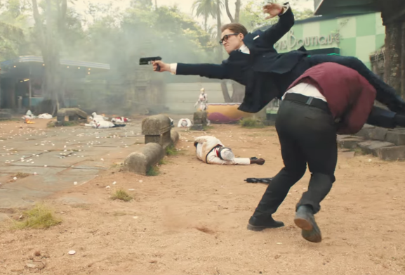 Eggsy eliminates guards while attempting to receive information from their boss, Poppy.