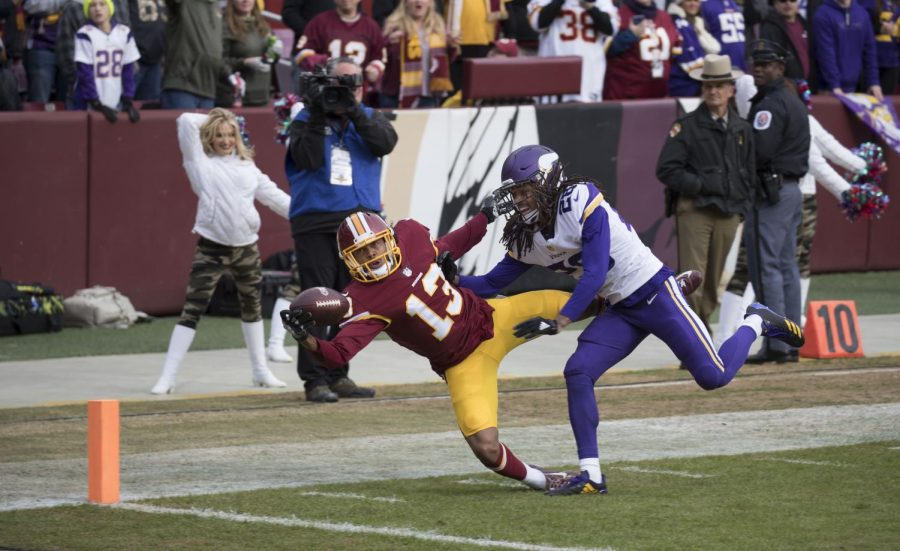 While falling, Washington wide receiver Maurice Harris makes a one-handed catch. Despite his efforts, Washington lost to the Minnesota Vikings by a score of 38-30.