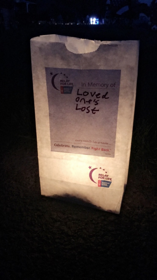 As part of Relay for Life's annual Luminara tribute, glow sticks and candles are positioned in bags inscribed with a name of a surviving cancer patient or one who has passed away. As the sunlight dwindles during the event, the candles are blown out and the glow sticks are cracked producing an array of awe-inspiring light. Although this may appear to be simply a bag of lights, its significance embodies the will and strength of cancer survivors in the presence of pain, as well as their light that shines from within.