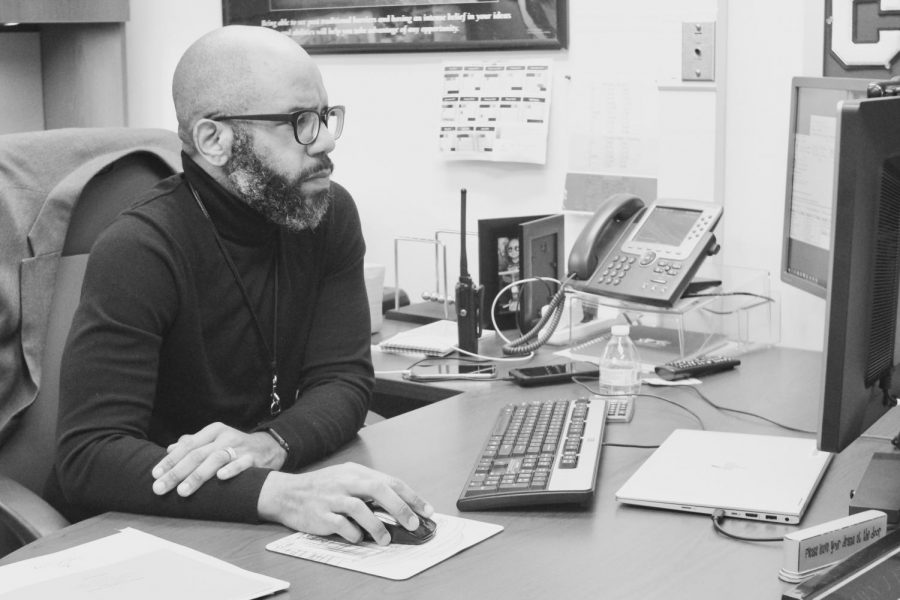 Assistant Principal Shawn Frank works in his office. Frank is the co-founder of LIFT, a program that aims to increase representation of students from low socioeconomic backgrounds.