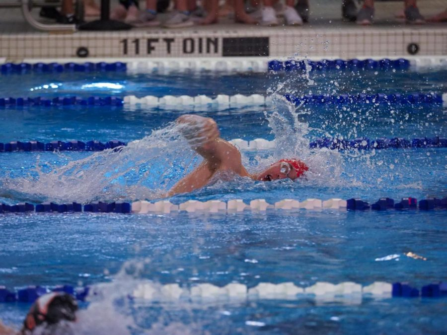 Johnathan Pollock speeds through the water at the swim states in GMU on Friday , Feb.16.