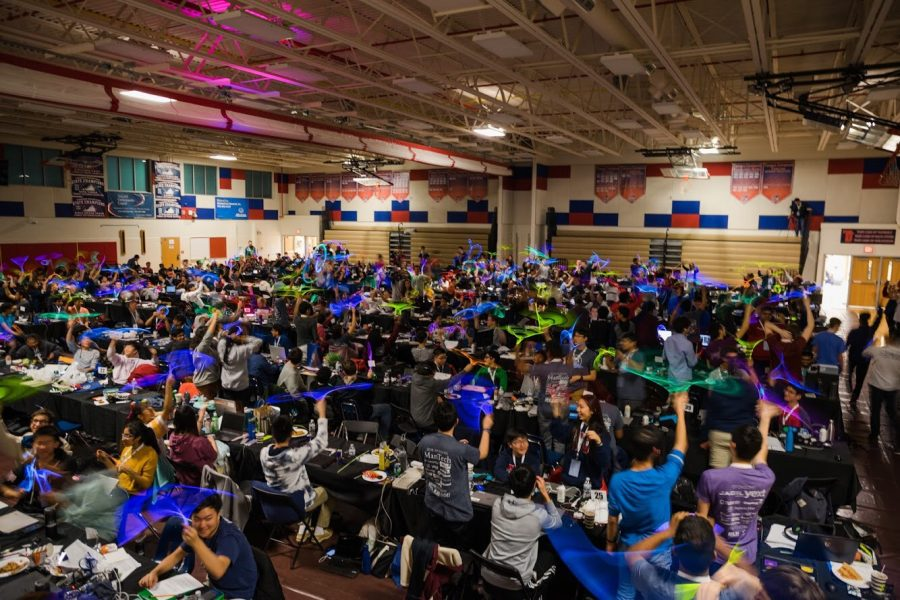 In Jefferson's main gym, students at HackTJ spin around glow-in-the-dark objects while taking a break.