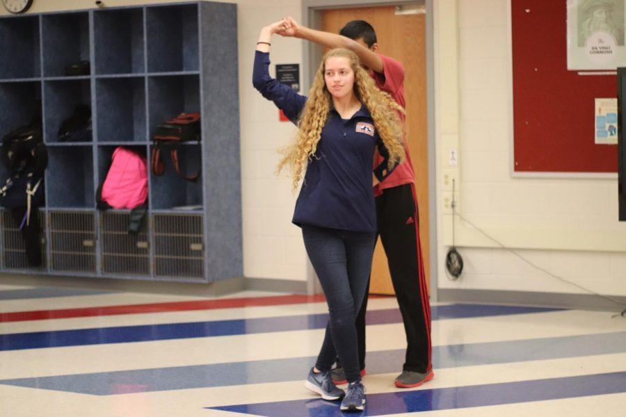 Sophomore Madelyn Khoury and  sophomore Atharva Haldankar practice the Hammerlock Turn.