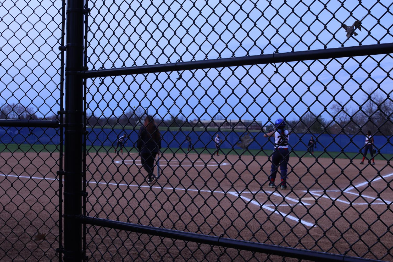 Jefferson+players+practiced+for+a+few+minutes+before+the+game+started.+Spectators+sit+behind+the+outfield+fence+as+they+watch+the+game.
