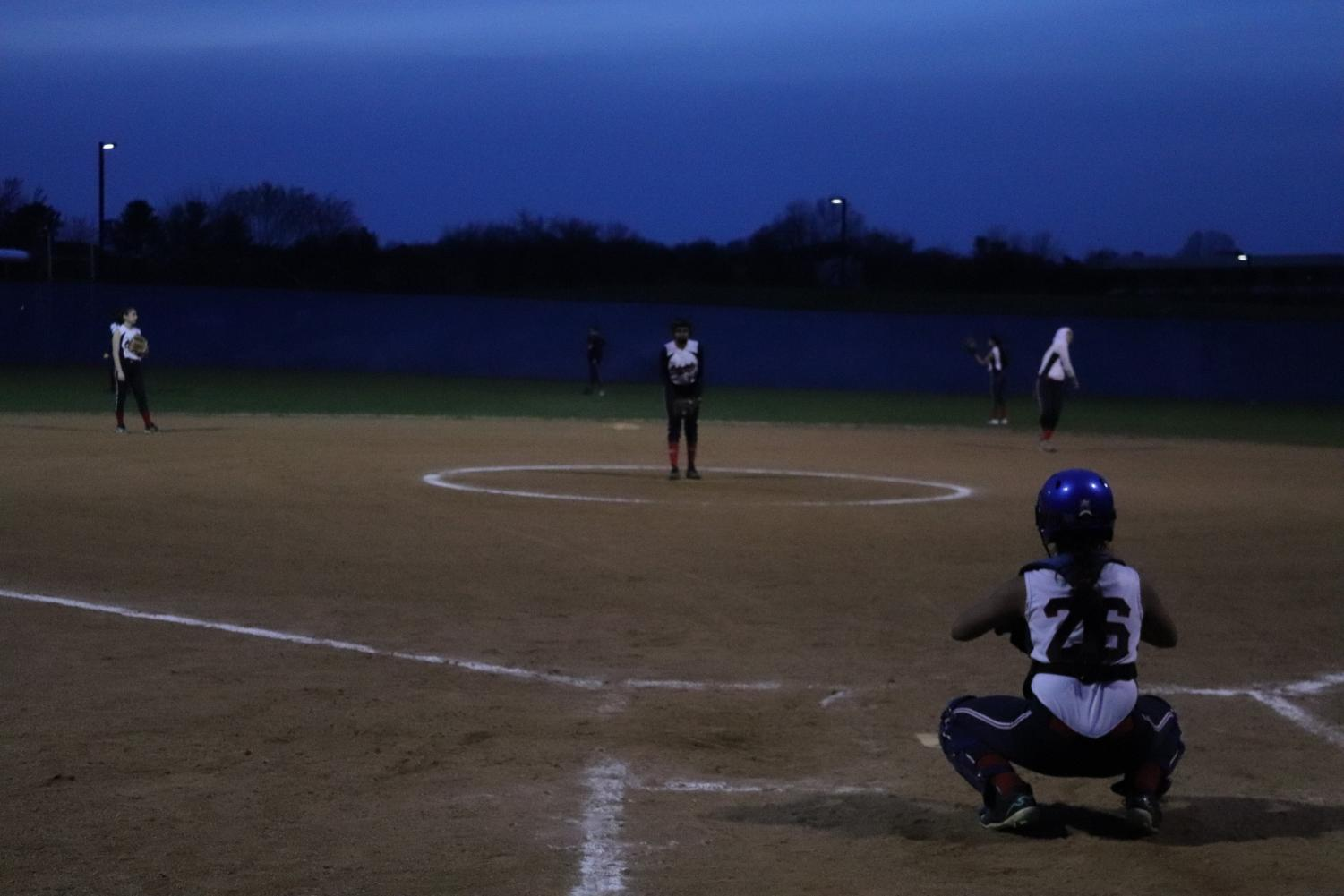 Sophomore+Anika+Kololgi+and+Gudipudi+practiced+pitching+and+catching+the+ball%2C+respectively%2C+before+the+next+inning+began.+Other+Jefferson+players+practice+as+well+with+more+balls.