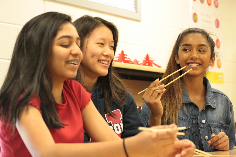 Freshmen+Nishitha+Vattikonda%2C+Sarah+Wang%2C+and+Trisha+Rayan+get+ready+for+the+competition.
