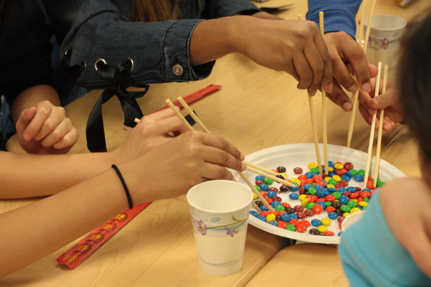 Students+race+to+see+who+can+wield+their+chopsticks+best.+