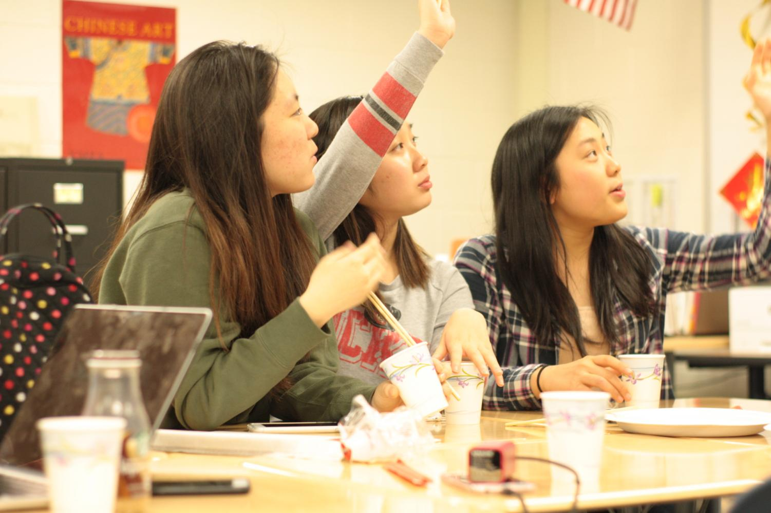 Students+call+out+answers+to+the+Chinese+themed+pictionary.