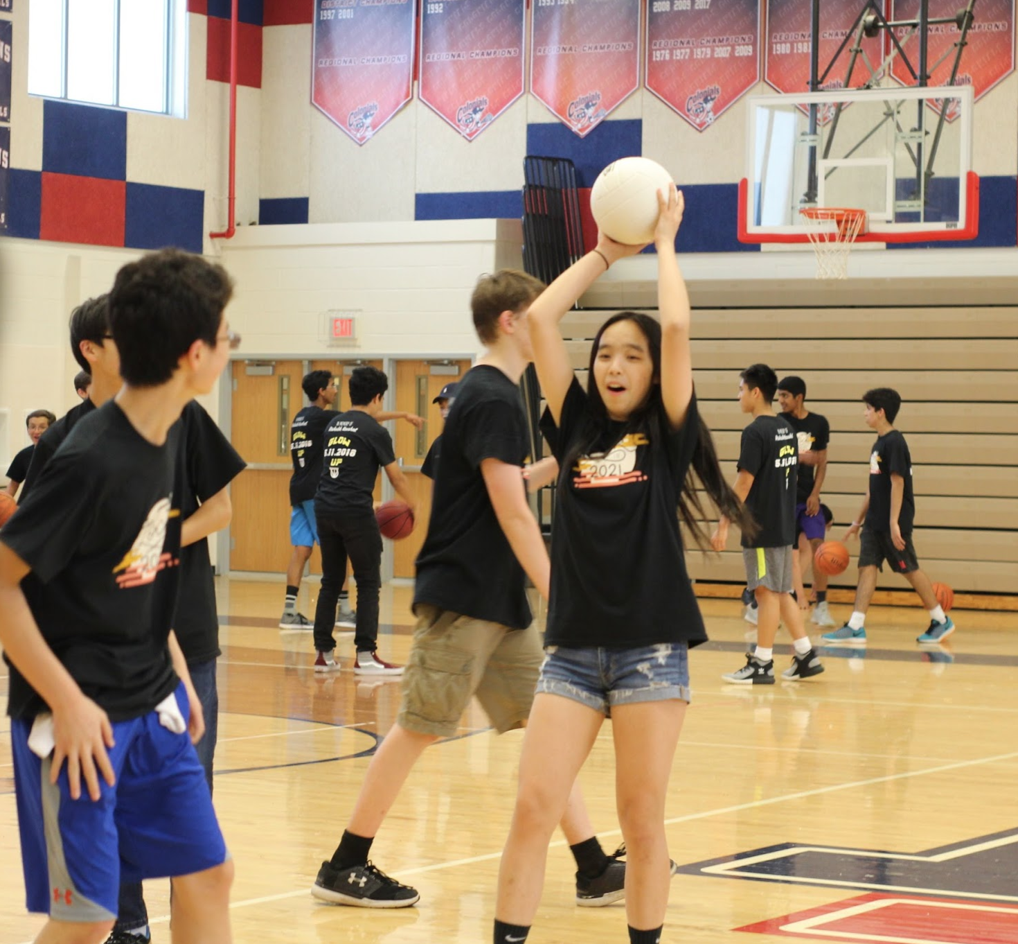 Miranda+Xiong+catches+a+volleyball+in+the+gym+while+waiting+for+Lock-In+to+start.