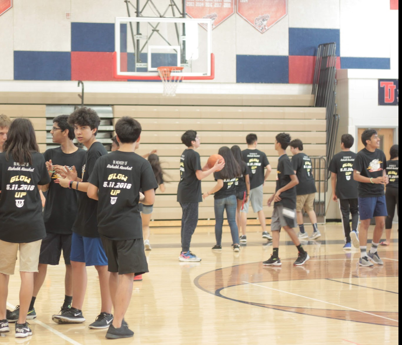 Donning their Lock-In shirts, freshmen entertain themselves in the gym before the event begins.