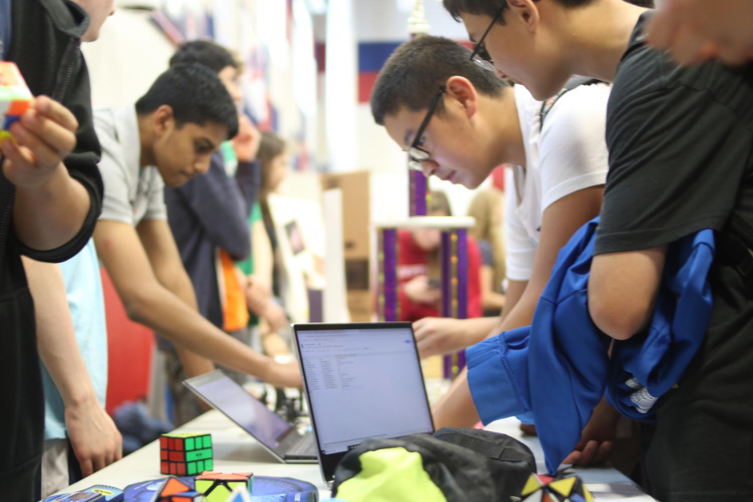 Students+add+their+name+to+the+email+list+at+the+TJ+Rubiks+Cube+Club+booth.+