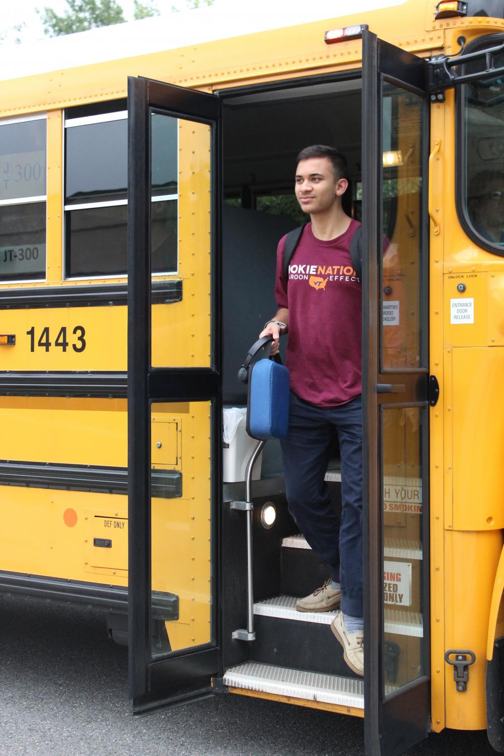 Senior Dheeraj Jassal exits his bus depot. With the elimination of neighborhood stops, Jassal is now forced to travel for a longer period of time daily.
