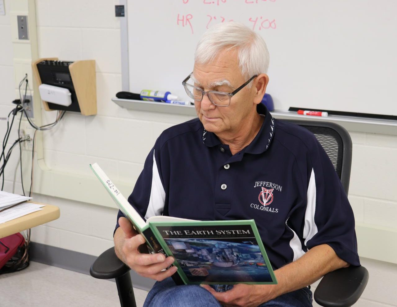 For his current role as a long-term geosystems substitute, retired Jefferson physics teacher James Rose refers to resources such as the textbook to better prepare for each day of class.