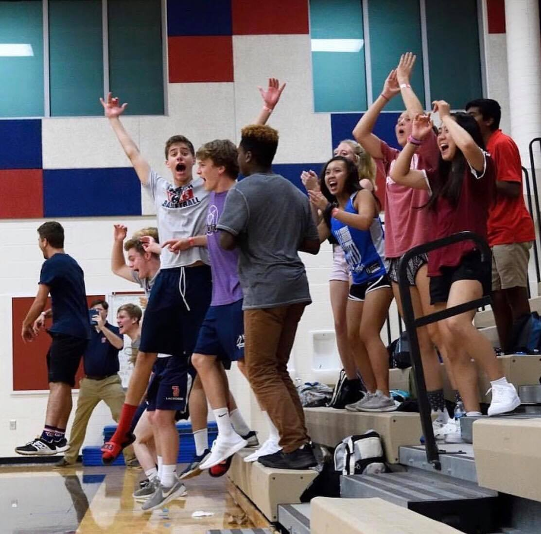During a Jefferson volleyball home game against Marshall High School, senior Will Pemble in purple cheers as the team scores a point.