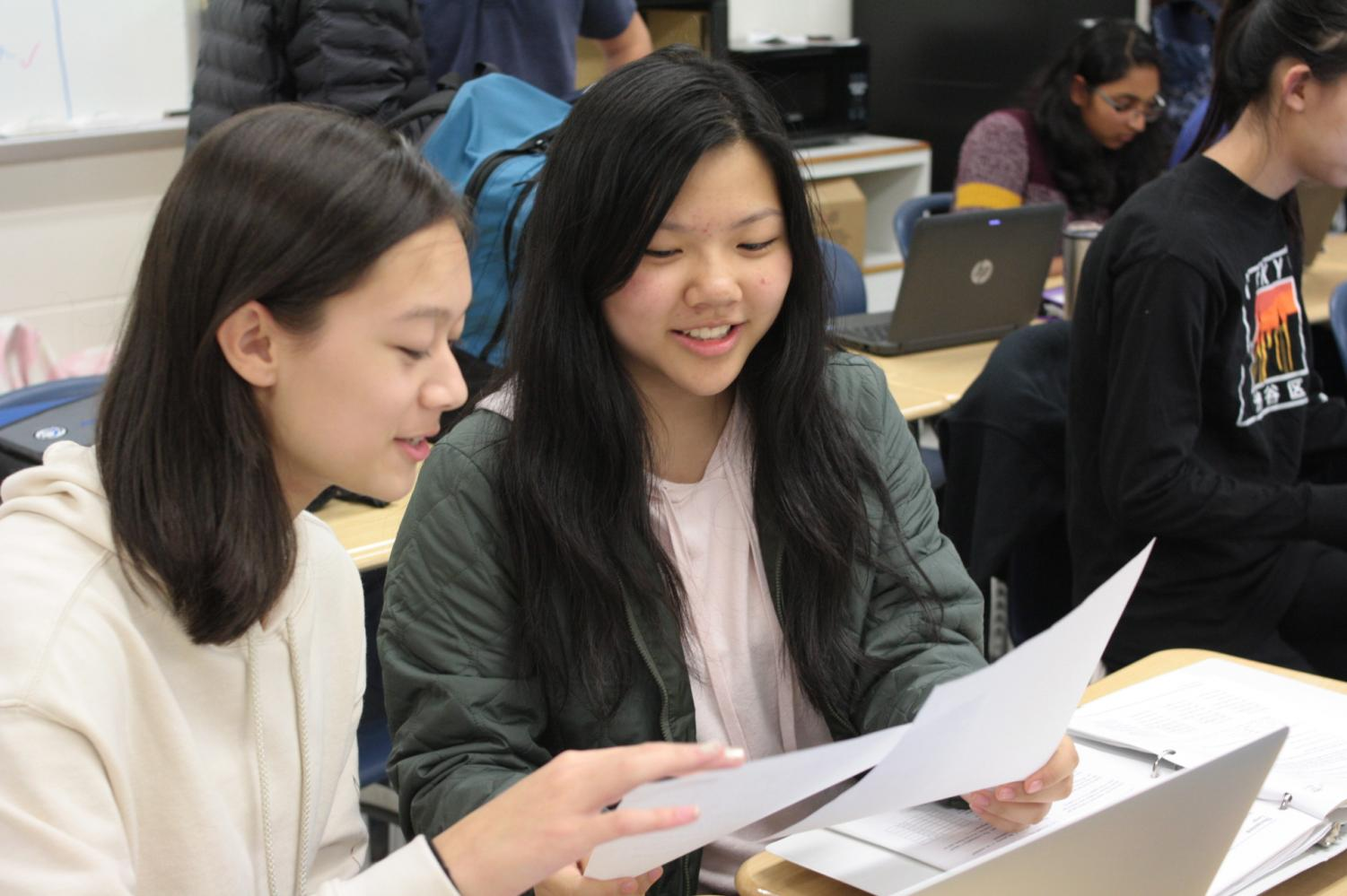 Every eighth period, Jefferson students spend time with younger students, hoping to inspire the same joy in learning they experience with their peers, like freshmen Alissa Rask and Alice Ji, at school.