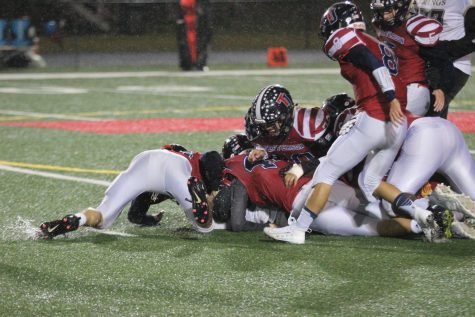 Varsity Football Team Loses to Justice Wolverines: Game Recap