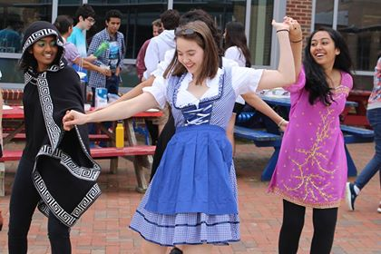 Attendees dance to German Music