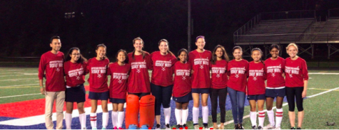 "The seniors and coaches of the Jefferson field hockey program stand together before the senior night game versus Lee on Oct. 4. The varsity team beat two of their four conference opponents this year, which is two more than last year. ""It's about progress, not perfection,"" Lear said. Photo courtesy of LifeTouch."