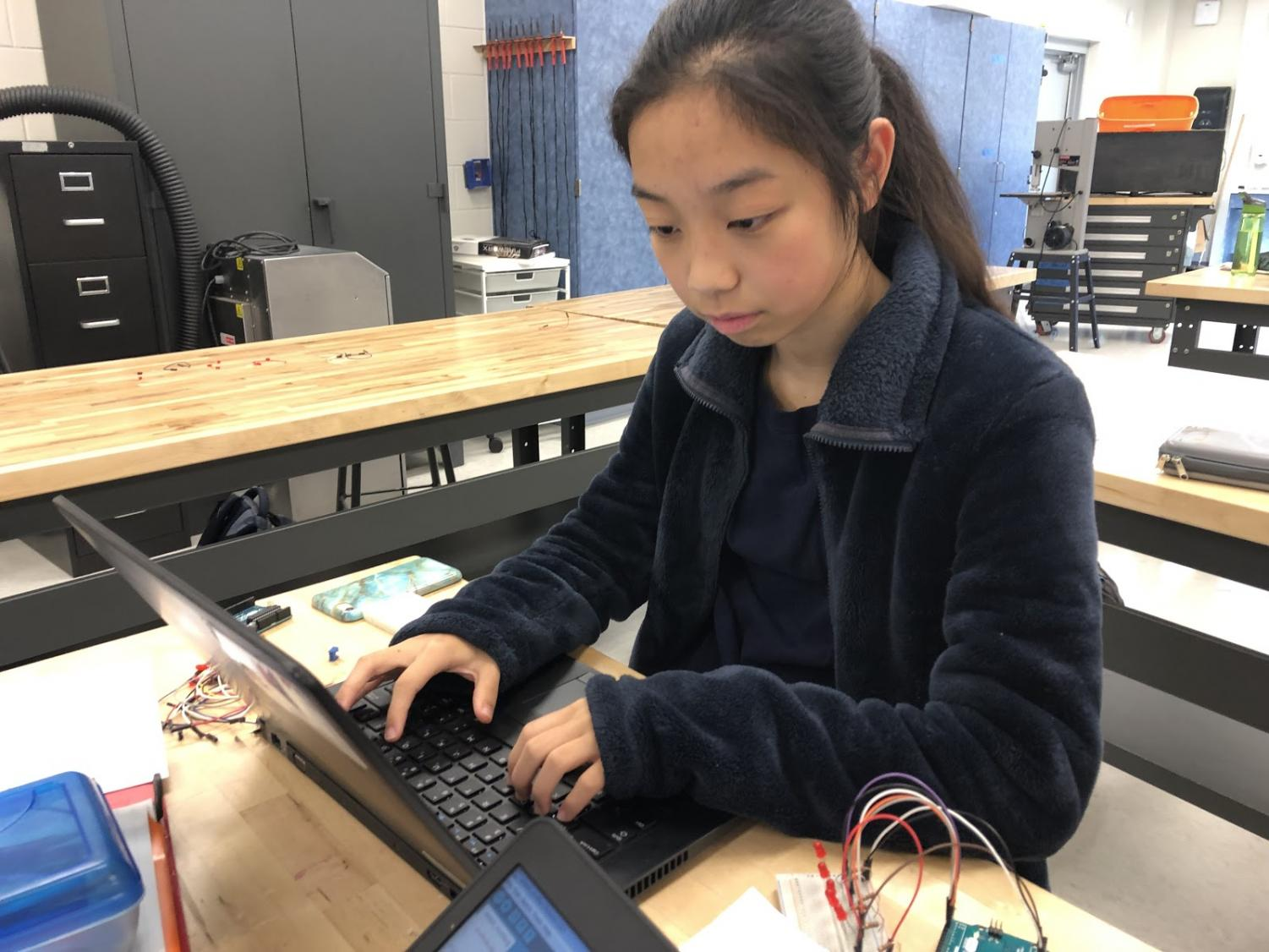 Freshman Joanna Cheng programming with an Arduino microcontroller during tech class at TJ. She was initially having difficulty trying to code a certain lab but quickly figured out the solution through determination.
