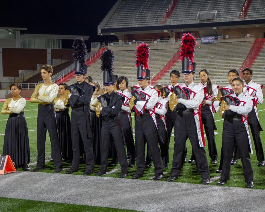 Decked out in their full performance uniforms, members of the Thomas Jefferson Marching Colonials pose at a competition. The group went on the road and brought their show in front of judges at Liberty University on Nov. 3. They did a total of five competitions this year and performed at the home football games.